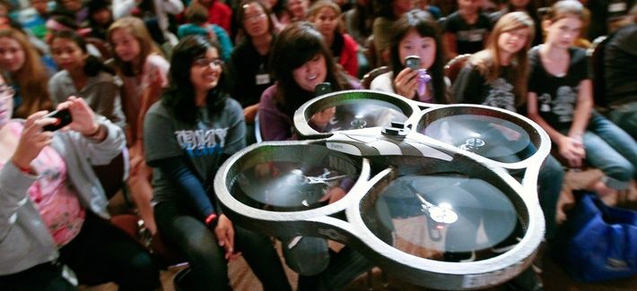 """A radio-controlled drone, dubbed """"Navy STEM Drone,"""" flies near audience members before the Oh! Zone show at the 12th annual Science Technology Education Partnership Conference in Riverside, Calif., Oct. 26, 2011."""