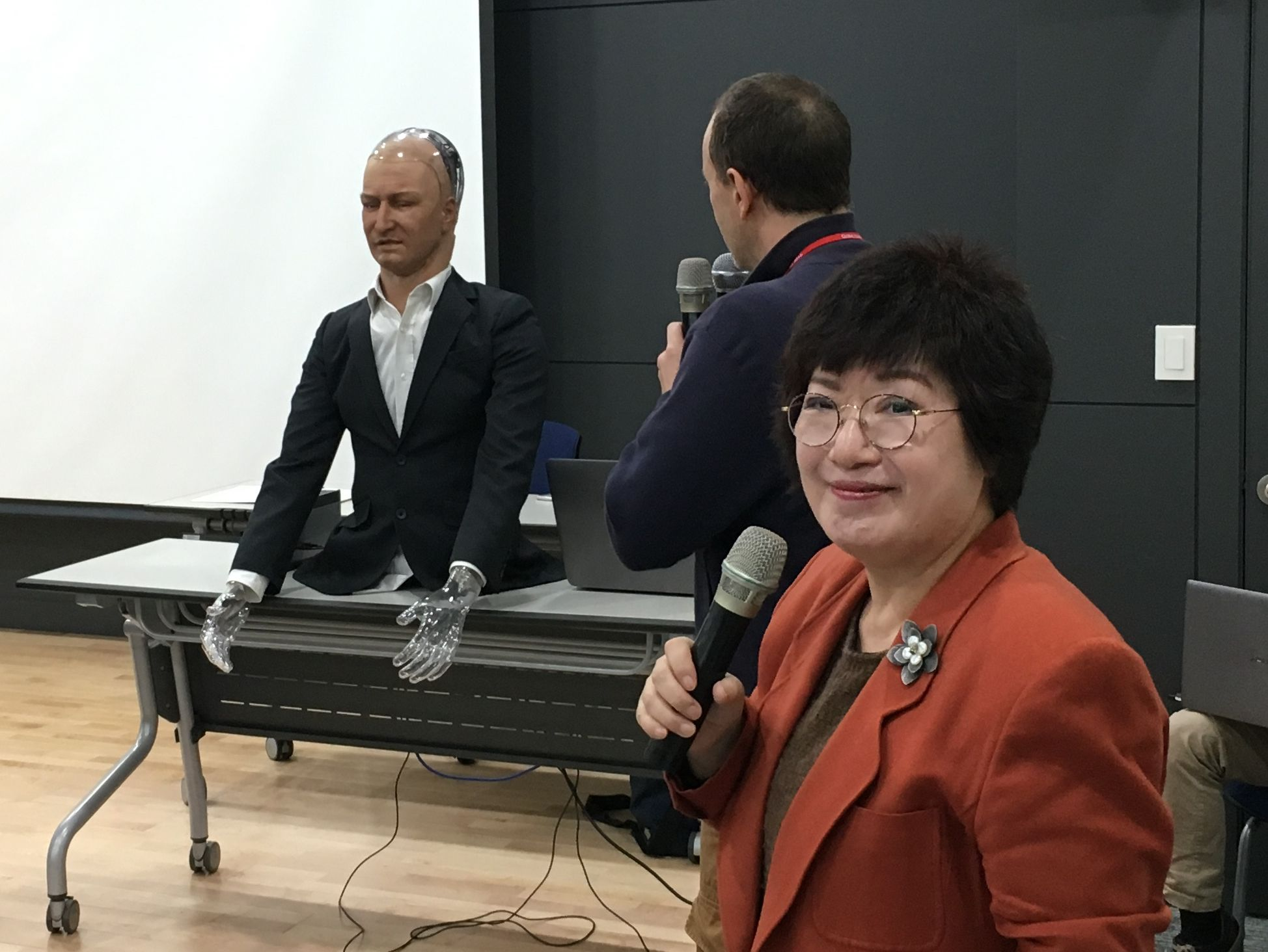Prof. Youngsook Park stands in front of the Han robot.