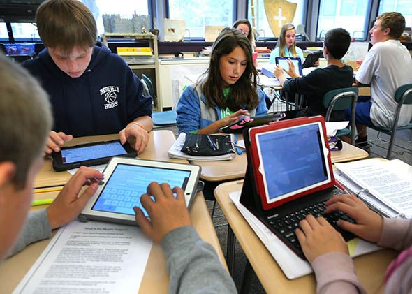 Students in teacher Cynthia McClellan's eighth grade social science and history class at the Blake Middle School use their iPads during class.