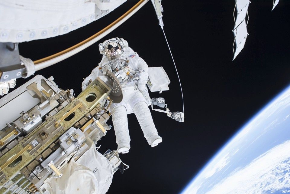 Expedition 46 Flight Engineer Tim Kopra performs a spacewalk outside the International Space Station in this December 21, 2015 NASA handout photo. Kopra and Expedition 46 Commander Scott Kelly successfully moved the International Space Station's mobile transporter rail car ahead of the December 23, 2015 docking of a Russian cargo supply spacecraft.  REUTERS/NASA/Handout via Reuters THIS IMAGE HAS BEEN SUPPLIED BY A THIRD PARTY. IT IS DISTRIBUTED, EXACTLY AS RECEIVED BY REUTERS, AS A SERVICE TO CLIENTS. FOR EDITORIAL USE ONLY. NOT FOR SALE FOR MARKETING OR ADVERTISING CAMPAIGNS - RTX1ZSVJ
