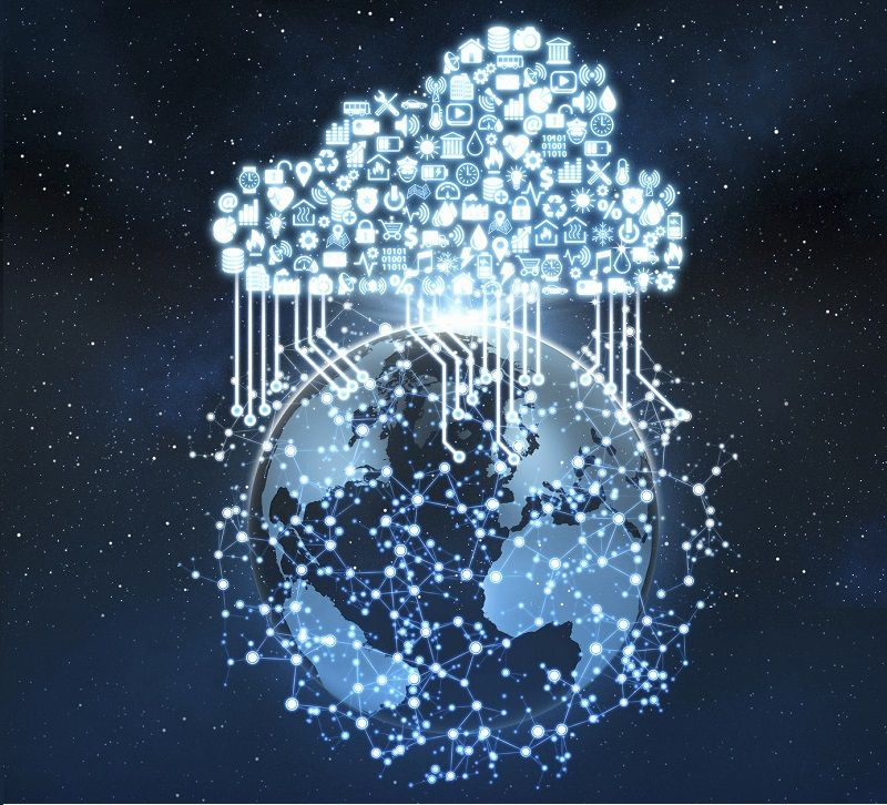 Cloud shaped set of icons with symbols of services and activities connecting planet Earth, floating in the outer space, surrounded by a complex network of glowing nodes linked by bright lines, extending in the deep blue space around the globe. Global business and communication technology connecting everything through cloud computing and the Internet of Things. Dark blue background.